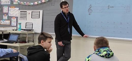 Teacher teaching his students in class
