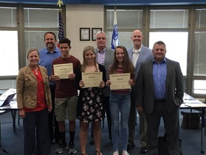 Students being awarded by the board members